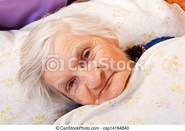 Elderly lonely woman rests in the bed - csp14164840