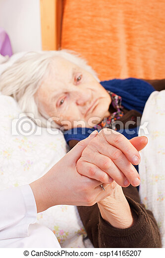 Elderly lonely woman rests in the bed - csp14165207