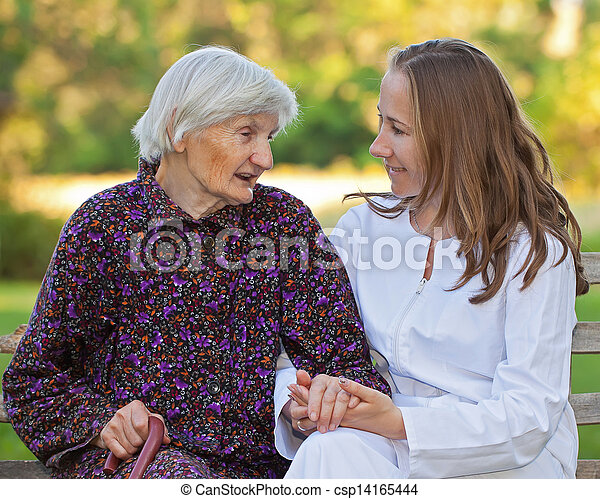 Elderly woman with the young doctor - csp14165444