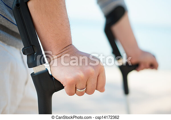 Injured Man Trying to walk on Crutches - csp14172362