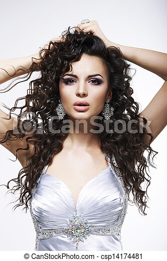 Sophistication. Fashionable Woman with Frizzy Hair with Earrings. Curly Hairstyle - csp14174481