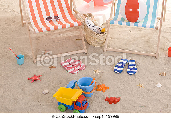 beach chair with colorful sand toys - csp14199999