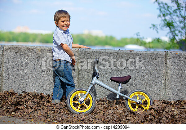 Little boy on a bicycle - csp14203094