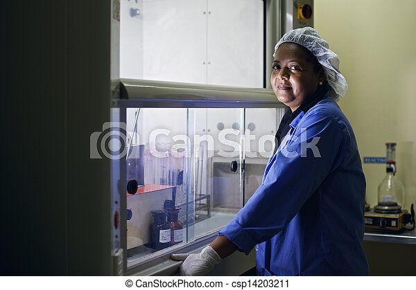 Medical research center, woman working in pharmaceutical lab - csp14203211