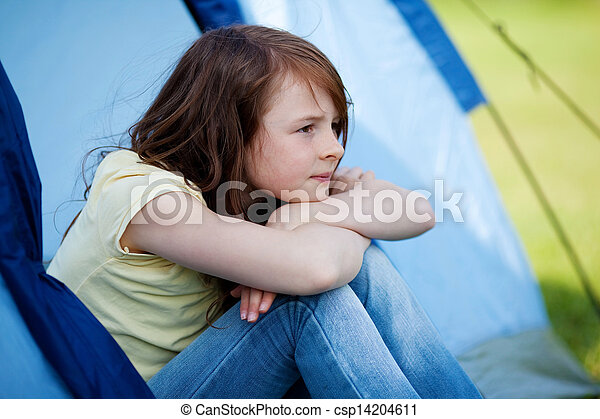 Girl Looking Away While Sitting In Tent