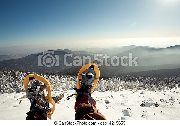 Hiker in winter mountains snowshoeing  - csp14215655