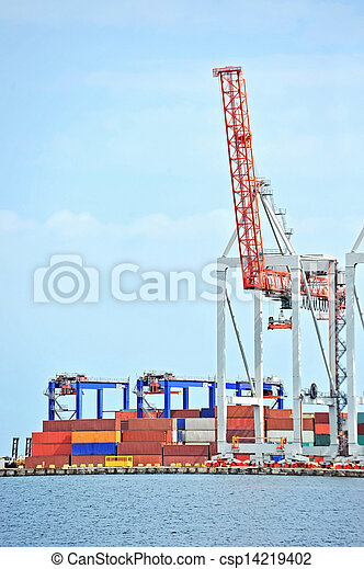 Port cargo crane and container over blue sky background - csp14219402