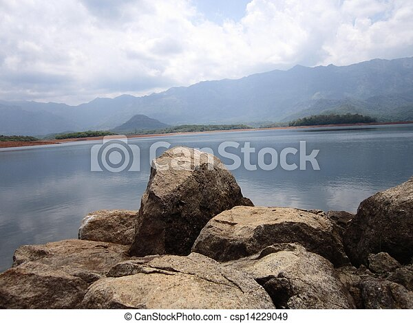 Rocky stones by the lake mountains - csp14229049