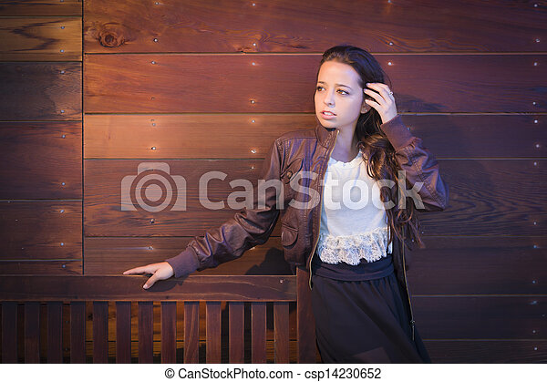 Mixed Race Young Adult Woman Portrait Against Wooden Wall - csp14230652