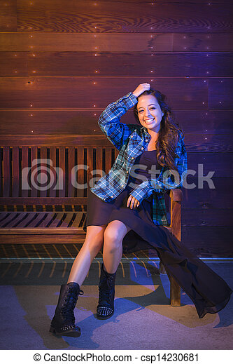 Mixed Race Young Adult Woman Portrait Sitting on Wood Bench - csp14230681