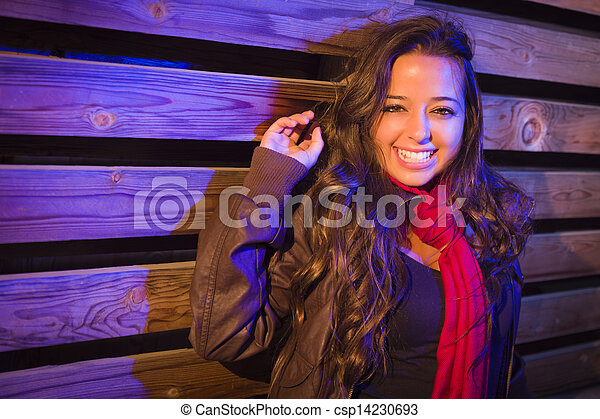 Mixed Race Young Adult Woman Against a Wood Wall Background - csp14230693
