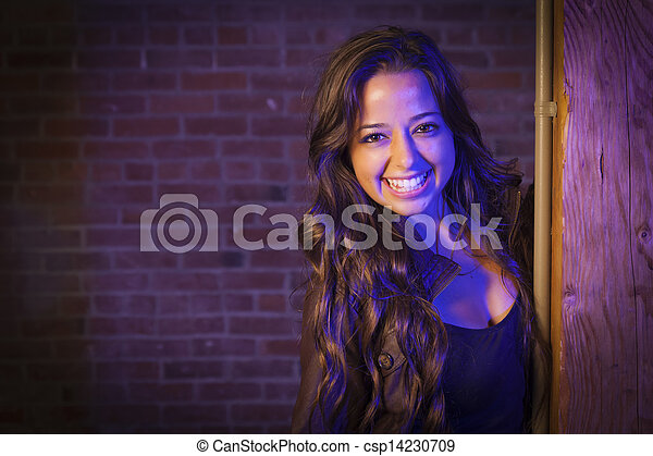 Pretty Mixed Race Young Adult Woman Against a Brick Wall - csp14230709