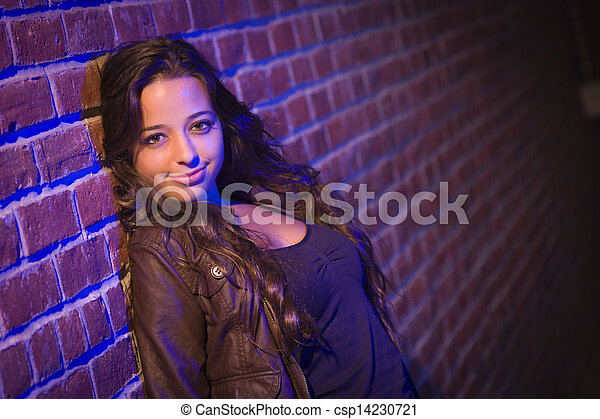 Pretty Mixed Race Young Adult Woman Against a Brick Wall - csp14230721