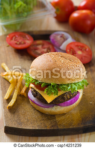 burger with fast food items and materials on the background - csp14231239