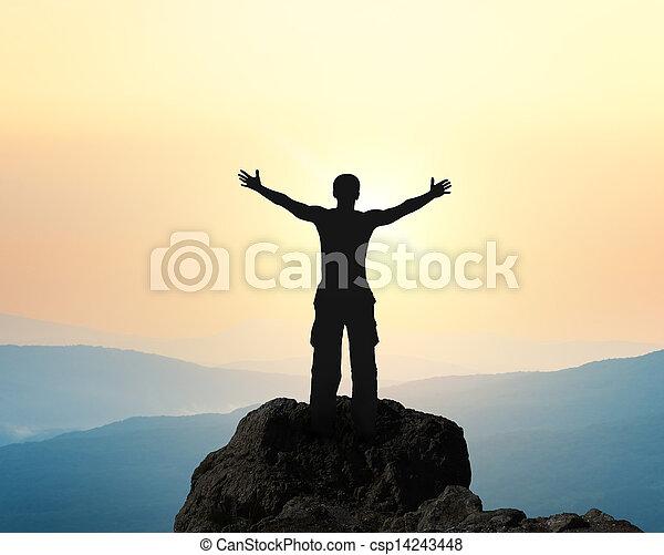 Man on top of mountain.  - csp14243448