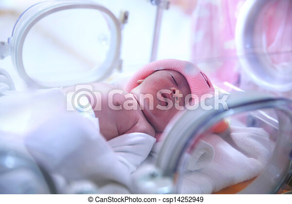 Newborn baby in hospital post-delivery room