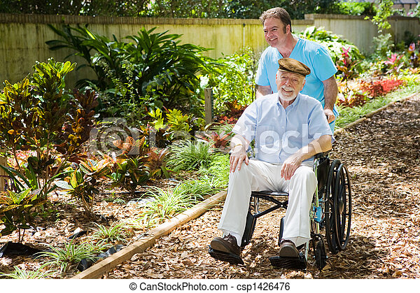 Disabled Senior Enjoying Garden - csp1426476