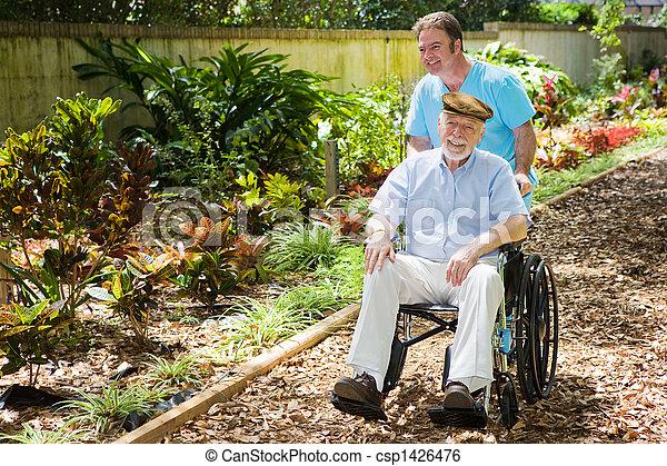 Disabled Senior Enjoying Garden - csp1426476