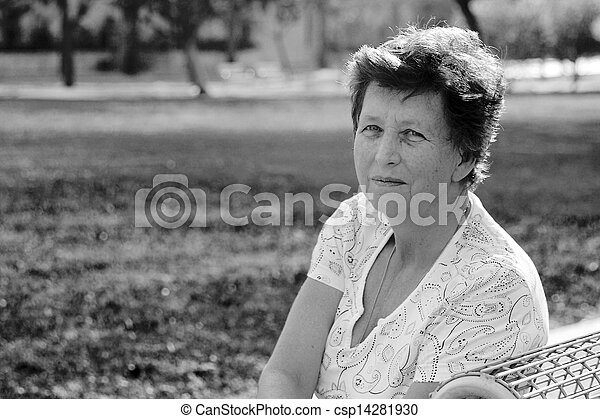 Portrait of 65-years-old beautiful woman outdoors. Beauty and wisdom of age