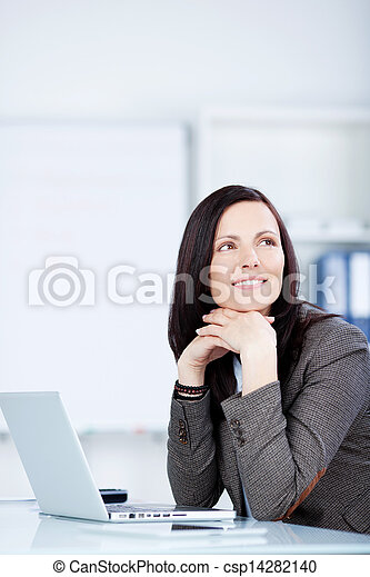 Pensive woman sitting at her desk - csp14282140