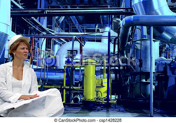 woman engineer, equipment, cables and piping as found inside of a modern industrial power plant            - csp1428228
