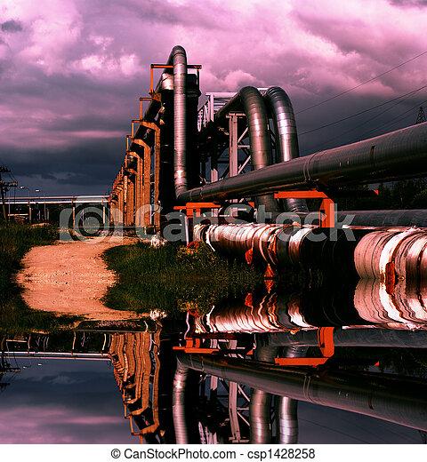 industrial pipelines on pipe-bridge against blue sky - csp1428258