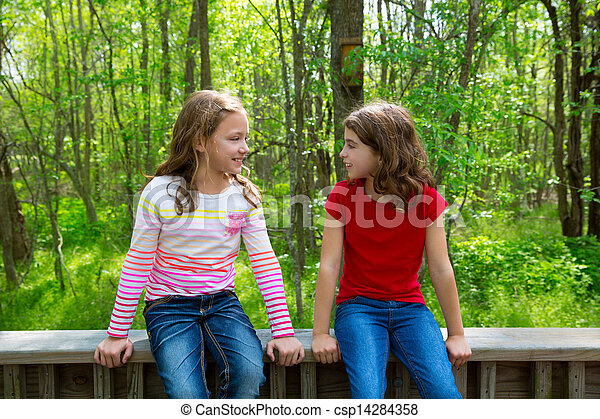 children friend girls talking on the jungle park forest - csp14284358