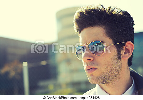 Attractive young man with sunglasses - csp14284428