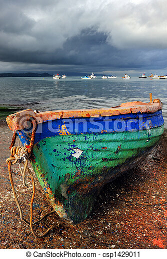 Stock Photography of Old colorful fishing boat - Picture of a laid out ...