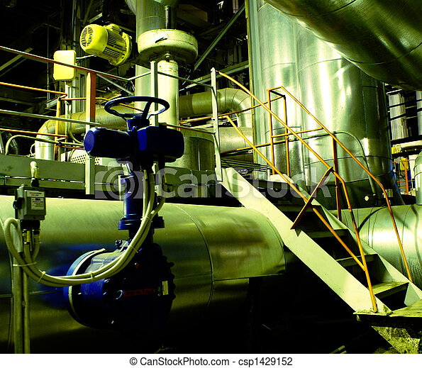 Pipes, tubes, machinery and steam turbine at a power plant - csp1429152