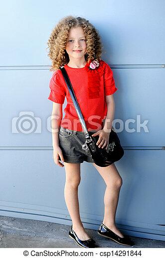 portrait of little girl outdoors iin the city