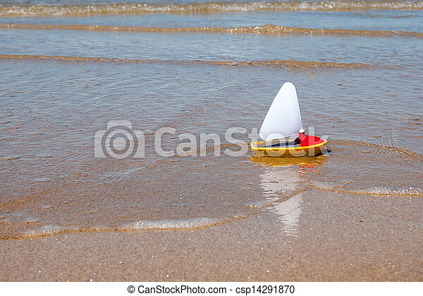 child's toy boat at the beach - csp14291870