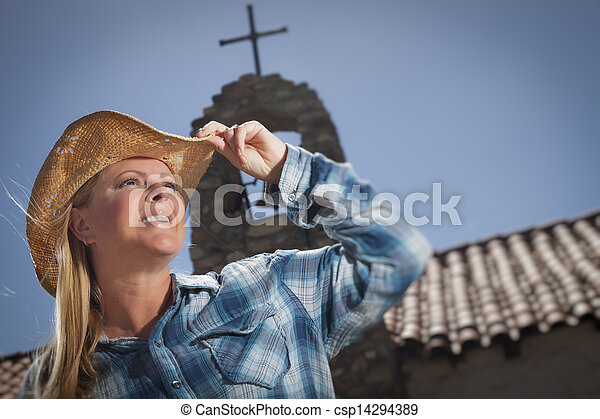 Beautiful Cowgirl Portrait with Old Church Behind - csp14294389