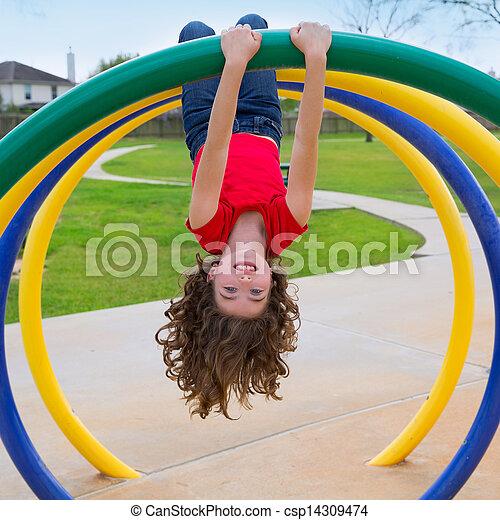 children kid girl upside down on a park ring - csp14309474