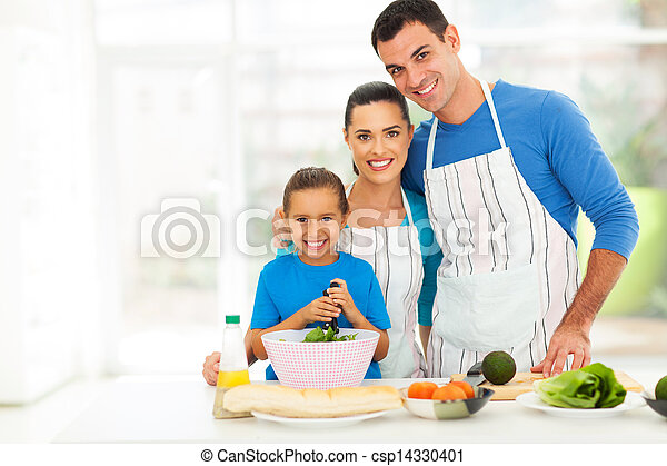 adorable young family cooking at home - csp14330401
