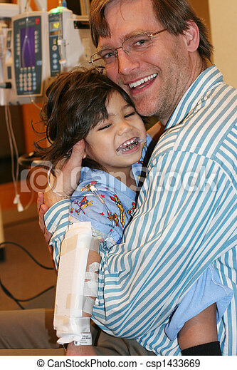 Father holding child in ER - csp1433669
