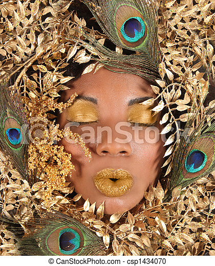 Woman Wrapped in Metallic Leaves and Peacock Feathers - csp1434070