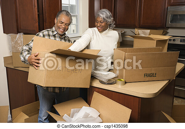 Couple packing boxes.