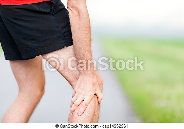Runner leg and muscle pain during running training outdoors - csp14352361