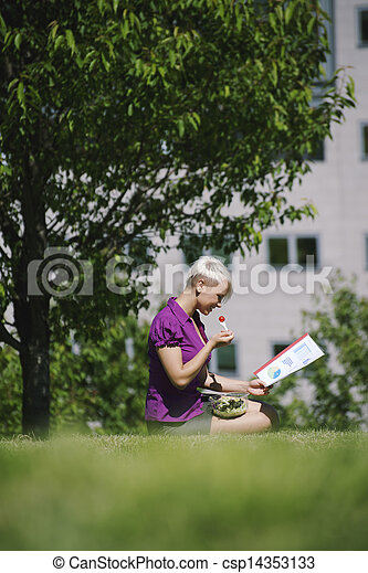 lunch break with business person eating vegetable in park - csp14353133