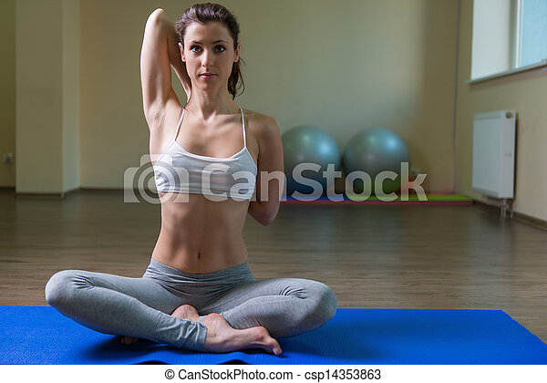 Young woman training in yoga asana - csp14353863