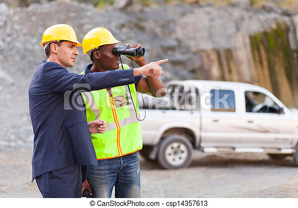 mine manager showing foreman mining site