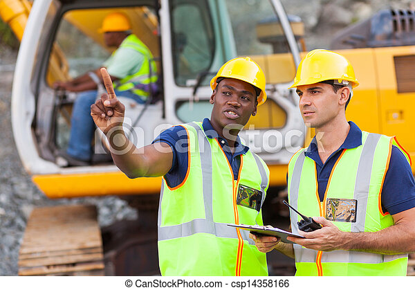 co-workers talking at construction site - csp14358166