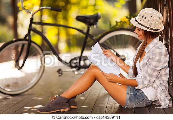 young woman studying at the park - csp14359111