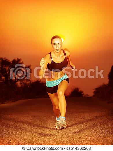 Sporty woman running on sunset - csp14362263
