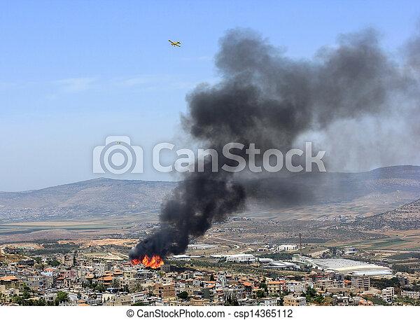 fire in the palestinian village of Mashhad near Nazareth - csp14365112