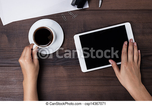 women hands with tablet computer and coffee on table - csp14367071