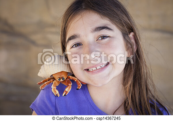 Young Girl Playing with Toy Hermit Crab - csp14367245
