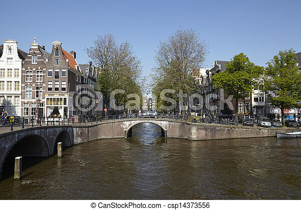 Amsterdam, Netherlands - Arch of bridges and old houses - csp14373556