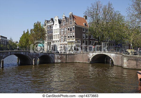 Amsterdam, Netherlands - Arch of bridges and old houses - csp14373663
